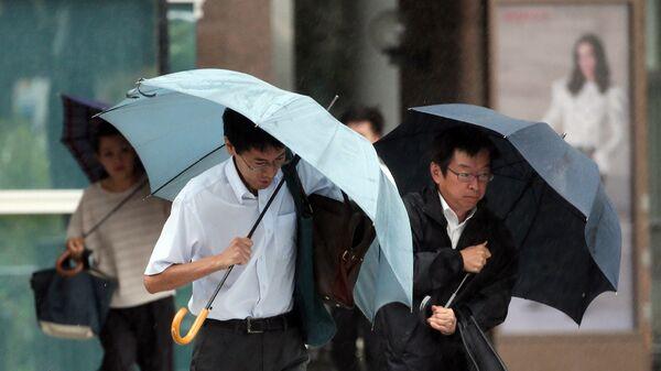 Тайфун Кило на улицах Хамамацу, Япония