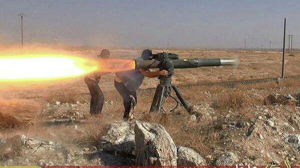 Боевики Исламского государства во время боя в районе города Хасеке на северо-востоке Сирии