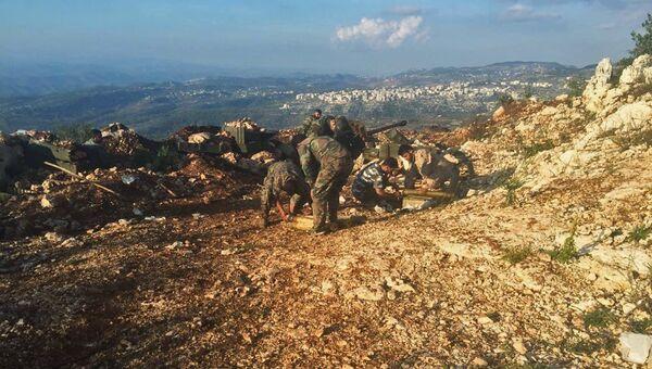 Военнослужащие сирийской армии в районе поселения Араму. Архивное фото