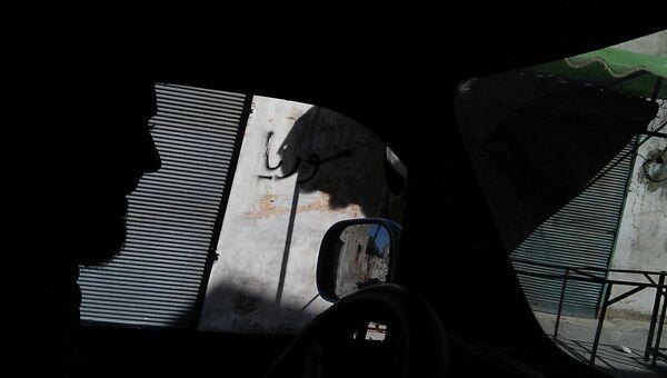 В автомобиле по улице Хомса, Сирия
