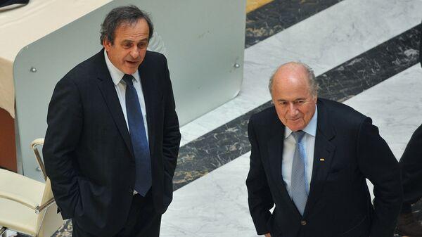 Президент УЕФА Мишель Платини и президент ФИФА Йозеф Блаттер