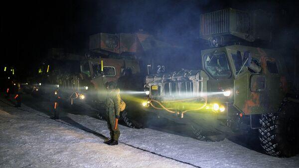 Машины обеспечения боевого дежурства перед маршем к месту учений