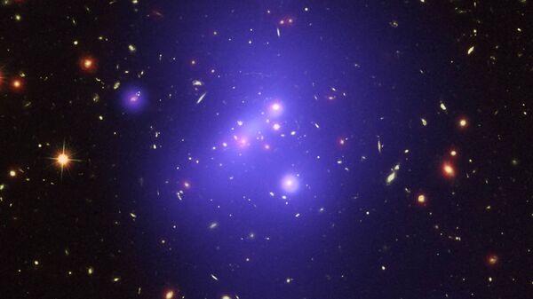 Основную массу скопления галактик IDCS 1426 составляет темная материя