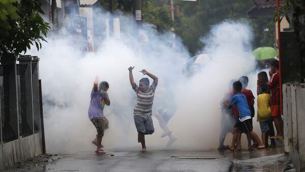 Распыленные инсектициды для борьбы с комарами, переносящими вирус Зика в Индонезии