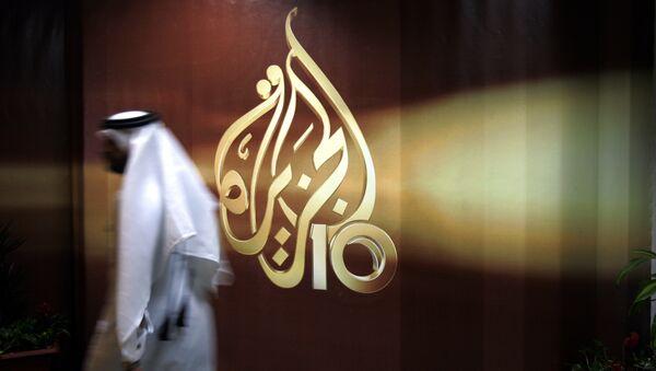 Сотрудник в офисе телекомпании Al Jazeera в Дохе, Катар