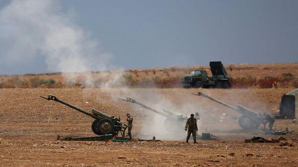 Сирийские военнослужащие на севере сирийской провинции Хама. Архивное фото