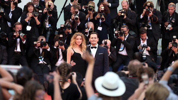 Голливудский актер Джонни Депп и актриса Эмбер Херд. Архивное фото
