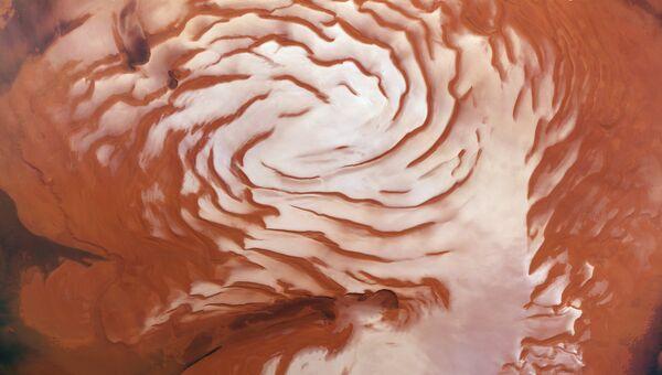 Эти спиральные структуры на полюсе Марса выдают историю наступлений и отступлений ледников красной планеты