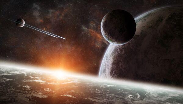 Восход солнца над группой планет. Архивное фото