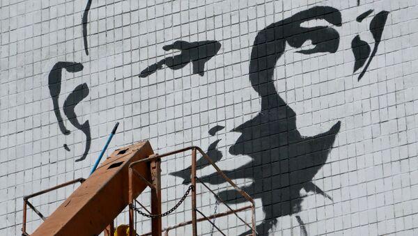 Граффити-портрет журналиста Олеся Бузины. Архивное фото