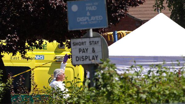 Сотрудник судебно-медицинской экспертизы на месте перестрелки в Линкольншире, Англия. 19 июля 2016