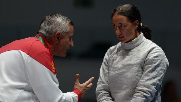 Яна Егорян и генеральный менеджер сборных команд России по сабле Кристиан Бауэр на XXXI летних Олимпийских играх