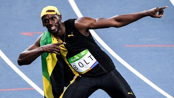 Усэйн Болт (Ямайка) после финиша в финальном забеге на 100 м во время соревнований среди мужчин по легкой атлетике на XXXI летних Олимпийских играх. 14августа 2016