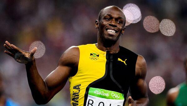 Усэйн Болт в финальном забеге на 100 м во время соревнований среди мужчин по легкой атлетике на XXXI летних Олимпийских играх