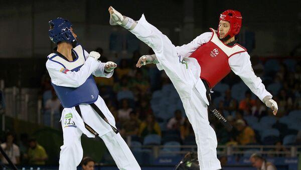 Российский тхэквондист Алексей Денисенко на Олимпиаде-2016 в Рио-де-Жанейро. 18 августа 2016