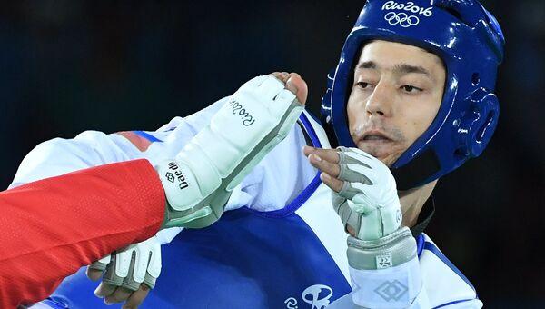Алексей Денисенко на соревнованиях по тхэквондо на XXXI Олимпийских играх