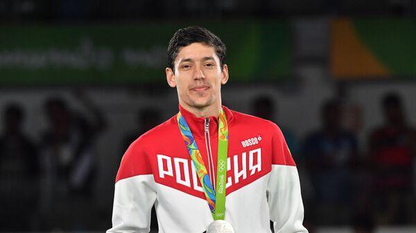 Алексей Денисенко, завоевавший серебряную медаль в соревнованиях по тхэквондо на XXXI Олимпийских играх