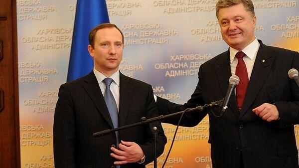 Председатель Харьковской областной государственной администрации Игорь Райнин и президент Украины Петр Порошенко. Архивное фотоо