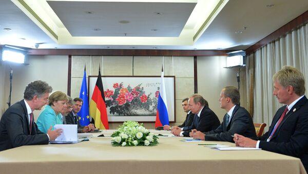 4 сентября 2016. Президент РФ Владимир Путин и канцлер ФРГ Ангела Меркель в Ханчжоу