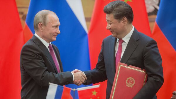 Президент России Владимир Путин и председатель Китайской Народной Республики (КНР) Си Цзиньпин. Архивное фото