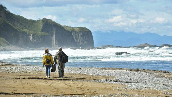 Мыс Столбчатый на берегу Охотского моря на западе острова Кунашир Большой Курильской гряды. Архивное фото