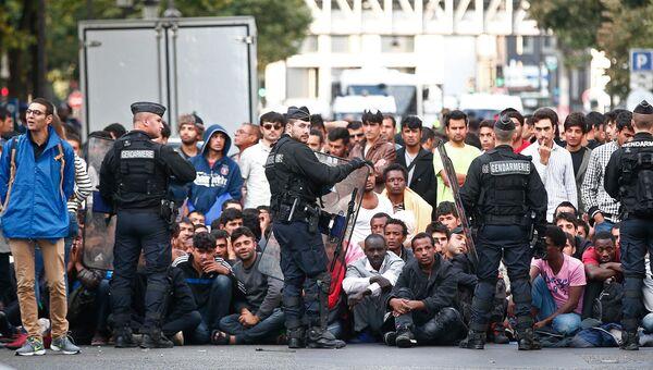 Эвакуация лагеря нелегальных мигрантов на севере Парижа. 16 сентября 2016