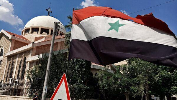 Государственный флаг Сирийской Арабской Республики. Архивное фото