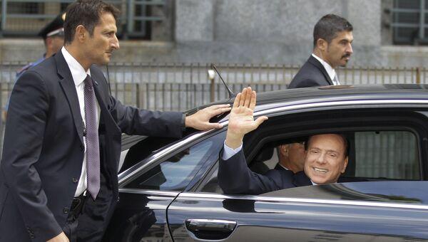 Сильвио Берлускони после посещения судебного заседания в Милане. 19 сентября 2011