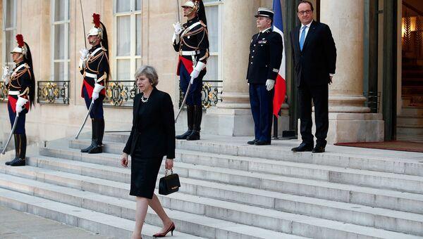 Британский политик Тереза Мэй и президент Франции, политический и государственный деятель Франсуа Олланд