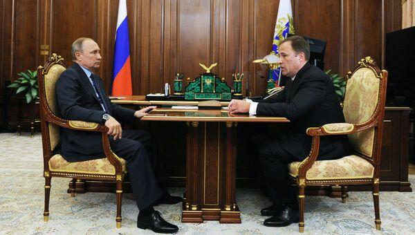 Владимир Путин и Игорь Комаров. Архивное фото