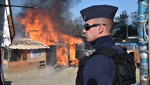 Пожар в лагере беженцев в Кале, Франция. 25 октября 2016