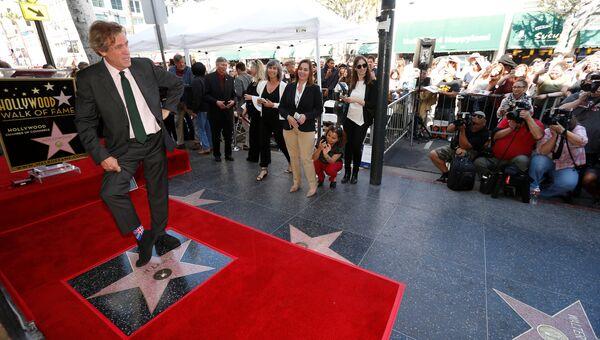 Британский актер Хью Лори на церемонии вручения звезды на Аллее славы в Голливуде. 26 октября 2016