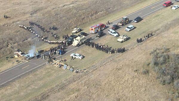 Разгон лагеря активистов, выступающих против строительства трубопровода в Северной Дакоте, США. Архивное фото