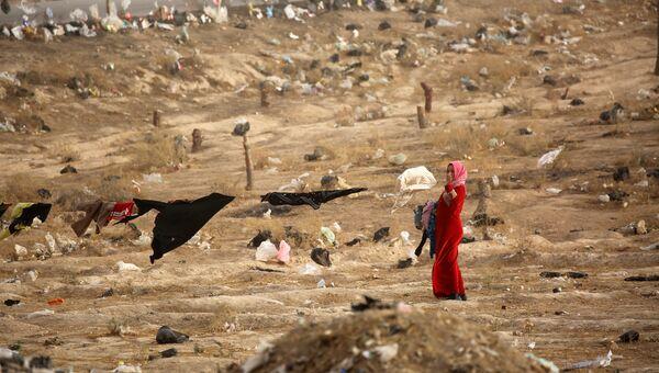 Женщина, покинувшая иракский Мосул во время операции против ИГ, в лагере для беженцев в Сирии
