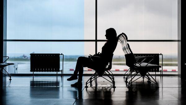 Пассажирка в аэропорту Кольцово в Екатеринбурге. Архивное фото