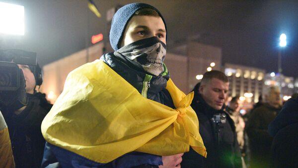 Участник акции по случаю третьей годовщины событий на киевском Майдане. Архивное фото