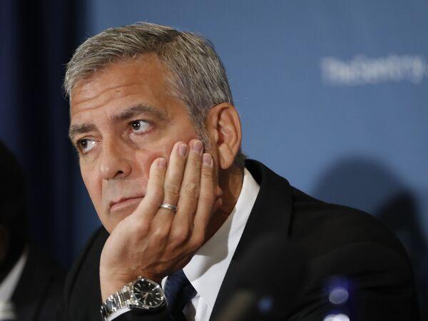 Американский актер Джордж Клуни во время пресс-конференции в Вашингтоне. 12 сентября 2016 года