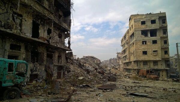 Здания, разрушенные в ходе боевых действий между правительственными войсками и боевиками в одном из районов восточной части сирийского Аллепо. Архивное фото