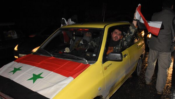 Жители Алеппо празднуют освобождение города от боевиков. 22 декабря 2016