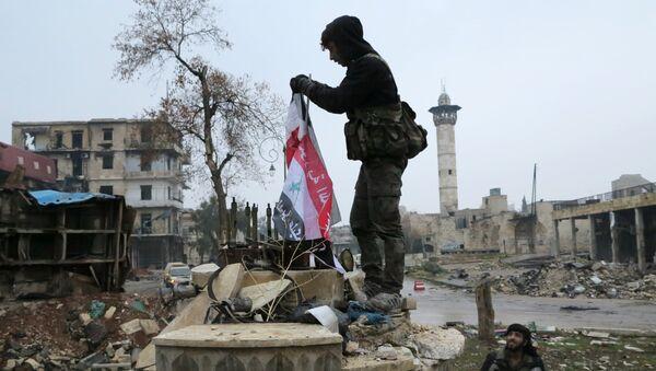 Военнослужащие в освобожденном квартале восточного Алеппо. Сирия, 13.12.2016