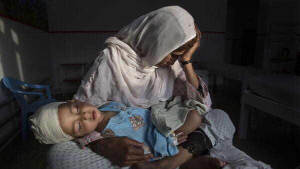 The Silent Victims of a Forgotten War фотографа Paula Bronstein занявшего первое место в категории Повседневная жизнь в фотоконкурсе World Press Photo