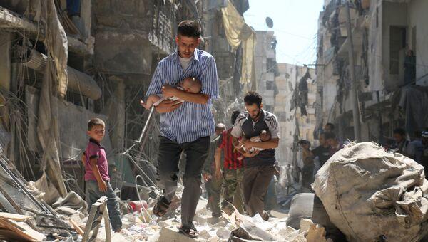 Rescued From the Rubble фотографа Ameer Alhalbi занявшего второе место в категории Горячие новости в фотоконкурсе World Press Photo
