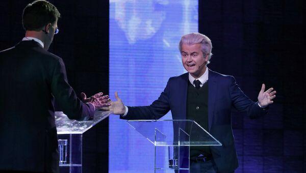 Премьер-министр Нидерландов Марк Рютте и лидер ультраправой Партии свободы Герт Вилдерс во время дебатов