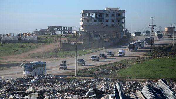 Боевики с семьями из пригорода Хомса прибыли в город Эль-Баб, Сирия. 19 марта 2017