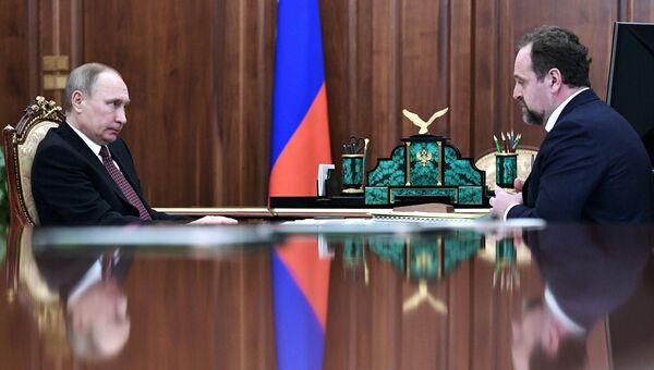 Президент РФ Владимир Путин и министр природных ресурсов и экологии РФ Сергей Донской. Архивное фото
