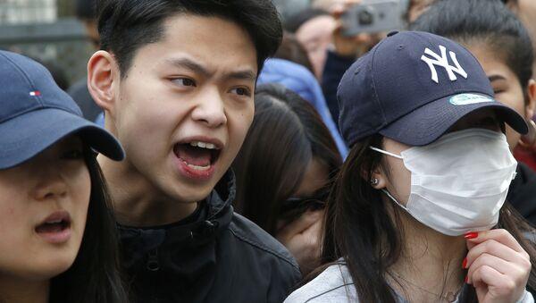 Акция протеста против убийства французскими полицейскими китайца в Париже. Архивное фото