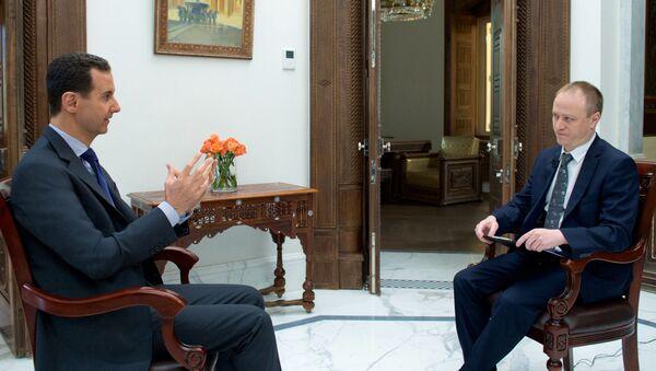 Президент Сирии Башар Асад и заместитель главного редактора МИА Россия сегодня Дмитрий Горностаев во время интервью