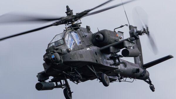 Вертолет AH-64 Apache на международных военных учениях Summer Shield XIV в Латвии