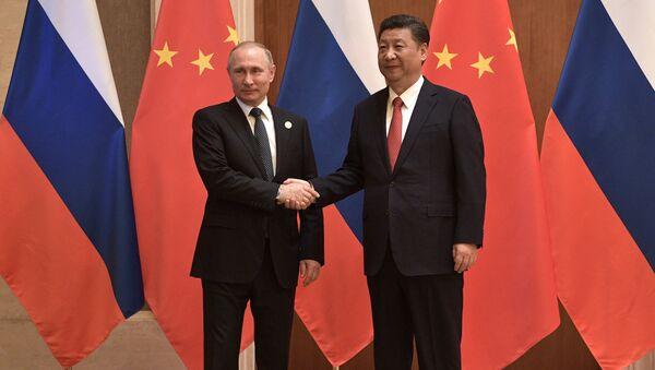 Президент РФ Владимир Путин и председатель КНР Си Цзиньпин во время российско-китайских переговоров в рамках Международного форума Один пояс, один путь. 14 мая 2017