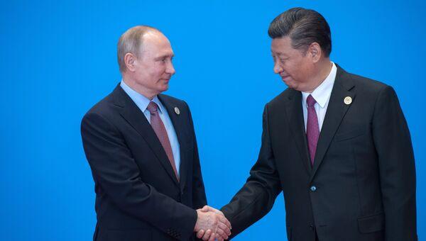 Президент РФ Владимир Путин и председатель Китайской Народной Республики Си Цзиньпин во время форума Один пояс, один путь в Пекине. 15 мая 2017